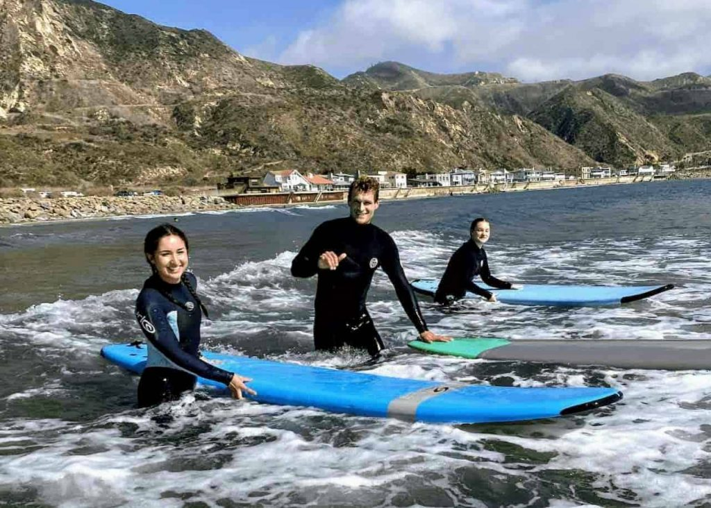 Learn to surf on a group surf lesson