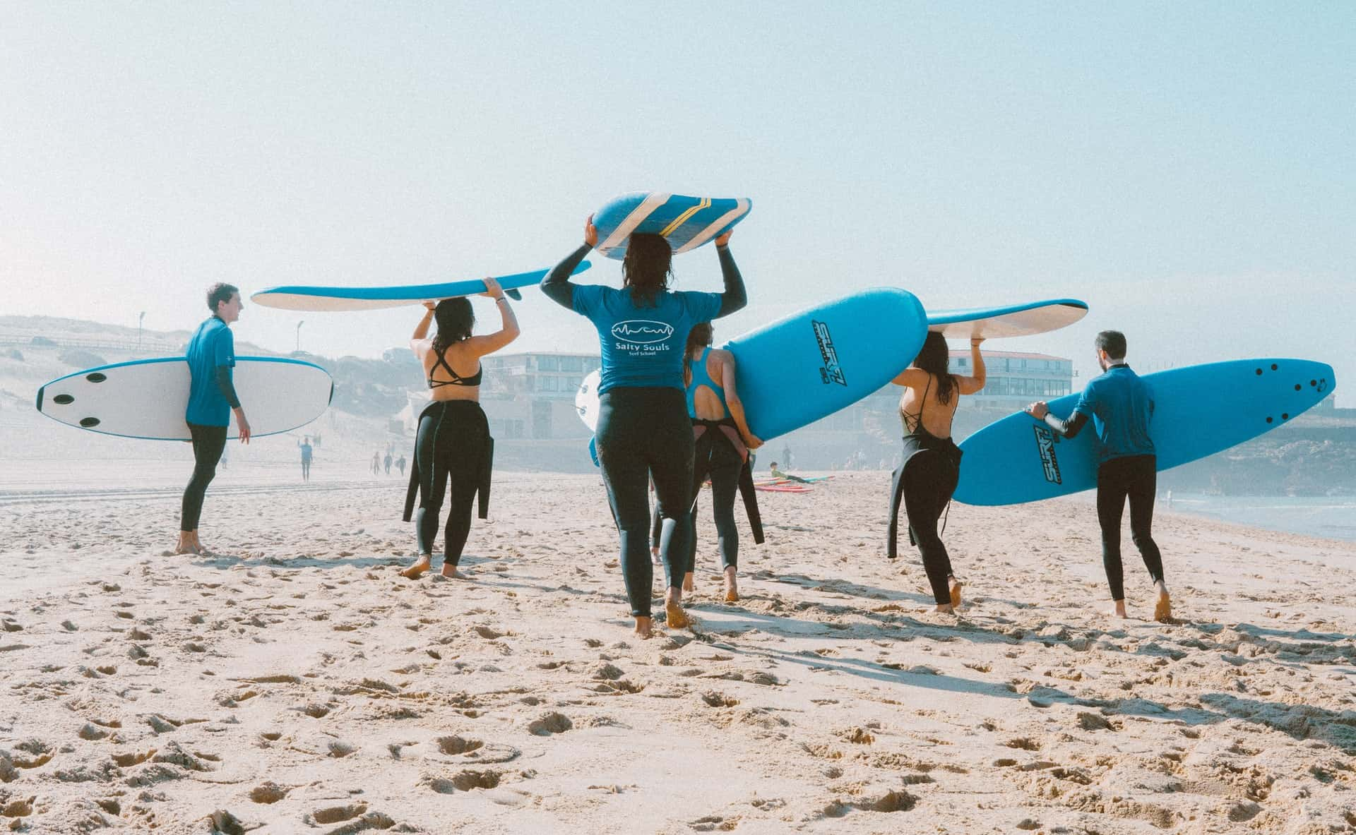 Group surf lessons gathering on beach image