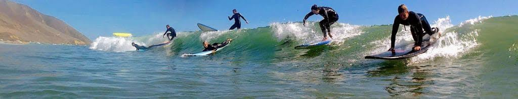 Santa Barbara Surf School group attempting wave image